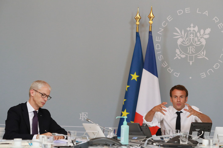 "French President Emmanuel Macron and Culture Minister Franck Riester (L) take part in a videoconference with artists from different fields at the Elysee Palace in Paris on May 6, 2020 before announcing the first orientations of a ""culture plan"" as France is under a strict lockdown to stop the spread of the Covid-19 pandemic caused by the novel coronavirus. (Photo by Ludovic MARIN / POOL / AFP)"